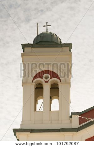Campanile on the left side of a christian church in Paros island at Greece.