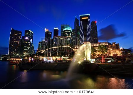 Singapore Skyline in commercial District on Merlion One Fullerton Park shine at dusk poster