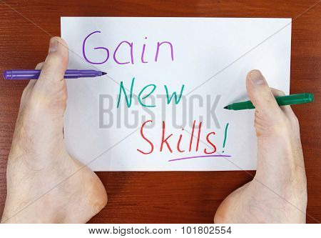 Note with text gain new skills written by feet poster