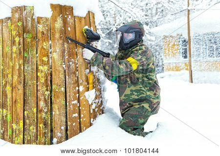 Beautiful Girl With Air Gun Playing Paintball In Winter