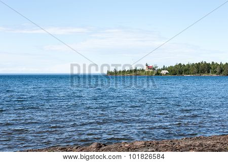 Lighthouse On A Peninsula In Lake Superior