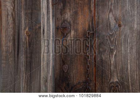 Old, Rusty Padlock On The Wooden Hangar Doors