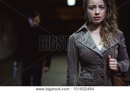 Young woman is afraid of terrible man poster