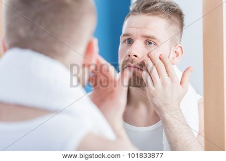 Male Narcissus Examining Complexion