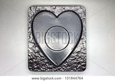 Empty plastic tray in heart shape