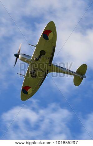 WW2 British Spitfire with landing gear down.