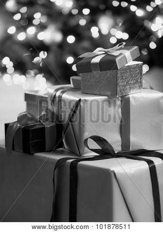 Black And White Photo Of Christmas Gift Boxes Lying On Floor
