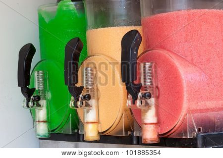 The machine gun doing the different frozen drinks