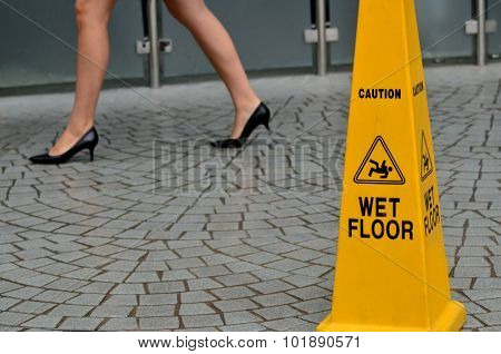 Slippery floor surface warning sign and symbol in building hall office hotel restaurant restroom. Concept photo danger.