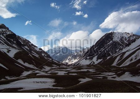 Aconcagua between clouds and mountains