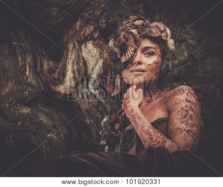 Nymph woman in a magical forest