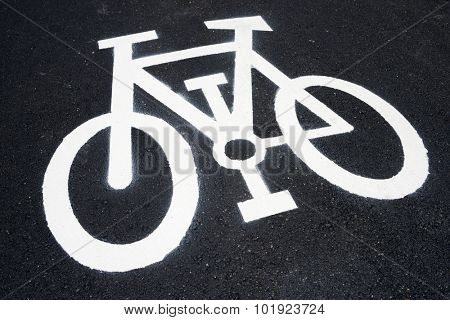 Bike lane sign painted on a street. poster