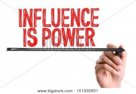 Hand with marker writing the word Influence is Power