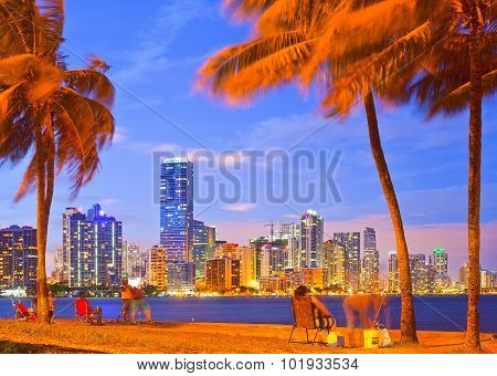 Night skyline and people fishing in Miami Florida