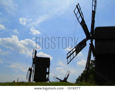 Black Wildmill On A Blue Sky Background