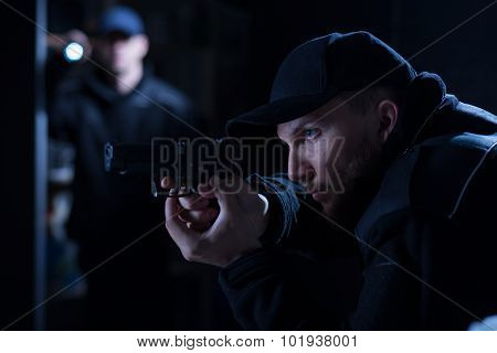 Police Officer Holding Handgun