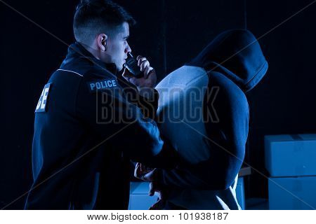 Policeman Arresting Law-breaker