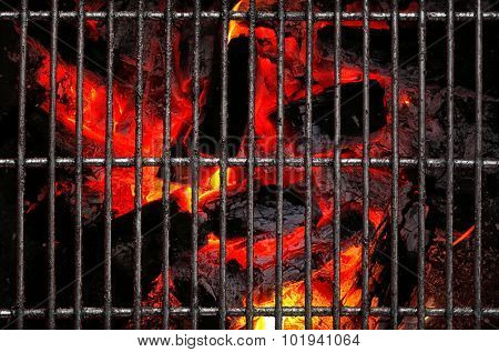 Empty Barbecue Grill with flaming hot wood fire and coals seen from above