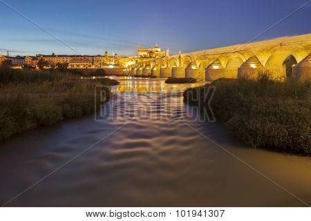 Guadalquivir River With Roman Bridge And Mosque