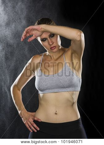 Sporty Woman Wiping Sweat on her Forehead