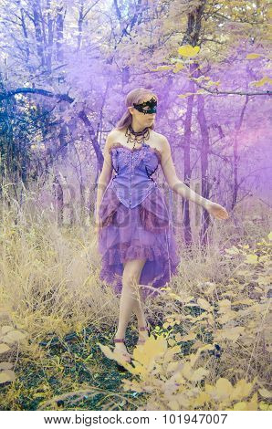 Mythical Woman Wearing Mask and Gown in Forest