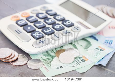 Calculator With Money On Grey Background