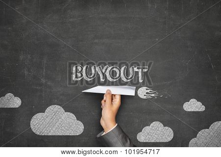 Buyout concept on blackboard with paper plane