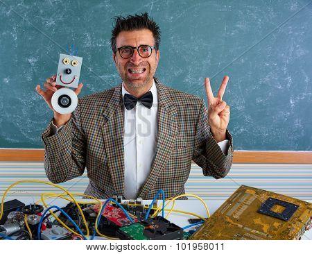 Nerd electronics technician silly teacher retro winner gesture with self made robot