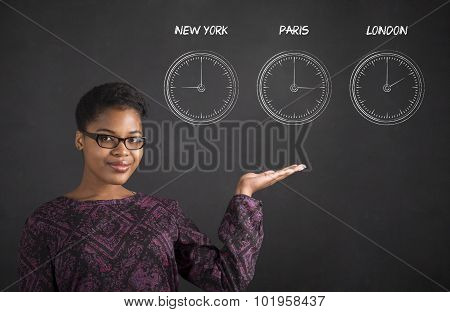 African Woman Holding Hand Out With Clocks On Blackboard Background