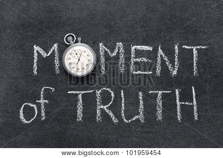moment of truth phrase handwritten on chalkboard with vintage precise stopwatch used instead of O poster