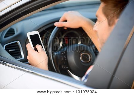Pleasant man driving a  car