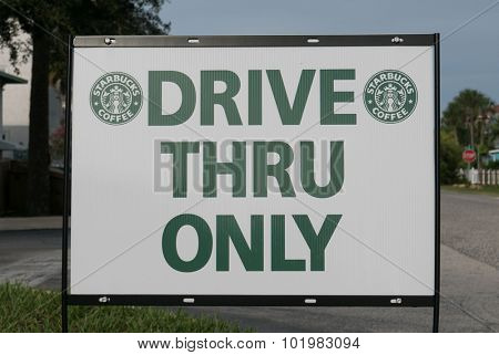 JACKSONVILLE, FL - AUGUST 14, 2015: A Starbucks Coffee Drive Thru Sign. Starbucks is the largest coffeehouse company in the world, with 20,891 stores in 62 countries (2014).