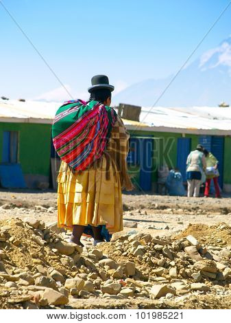 Bolivian cholita walking on the street of El Alto