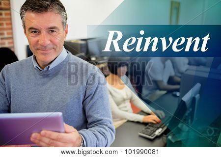 The word reinvent against teacher holding a tablet pc