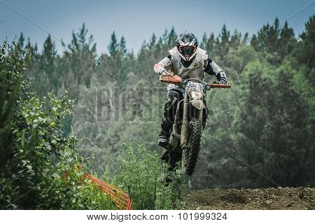 Motocross driver jump over the mountain