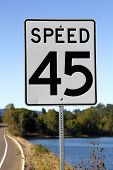 "A Speed sigh reads ""45"" along a country road in Oregon. (USA) poster"