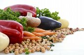 Vegetarian food including vegetables nuts and legumes with copy space on white background. poster