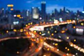 Blurred bokeh lights of city freeway intersection with city background, Bangkok Thailand poster
