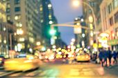 New york City abstract rush hour - Defocused yellow taxi cabs and traffic jam on 5th avenue in Manhattan downtown at blue hour - Blurred bokeh postcard on a retro vintage nostalgic filtered look poster