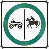 Regulatory road sign in Quebec Canada - Equestrian and ATV lane. poster