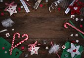 Wooden background with christmas and craft elements and empty space in the middle, vignetting poster