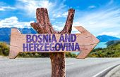 Bosnia and Herzegovina wooden sign with road background poster