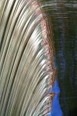 a close up of a waterfall with reflected blue sky **Note slight graininess,  best at small sizes. poster