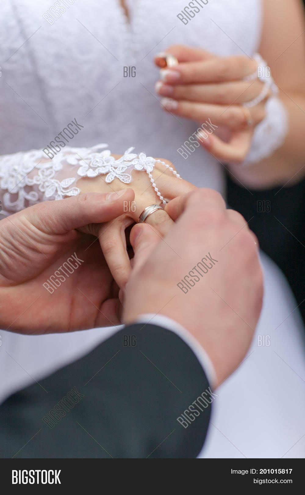 Husband Puts Wedding Image & Photo (Free Trial) | Bigstock