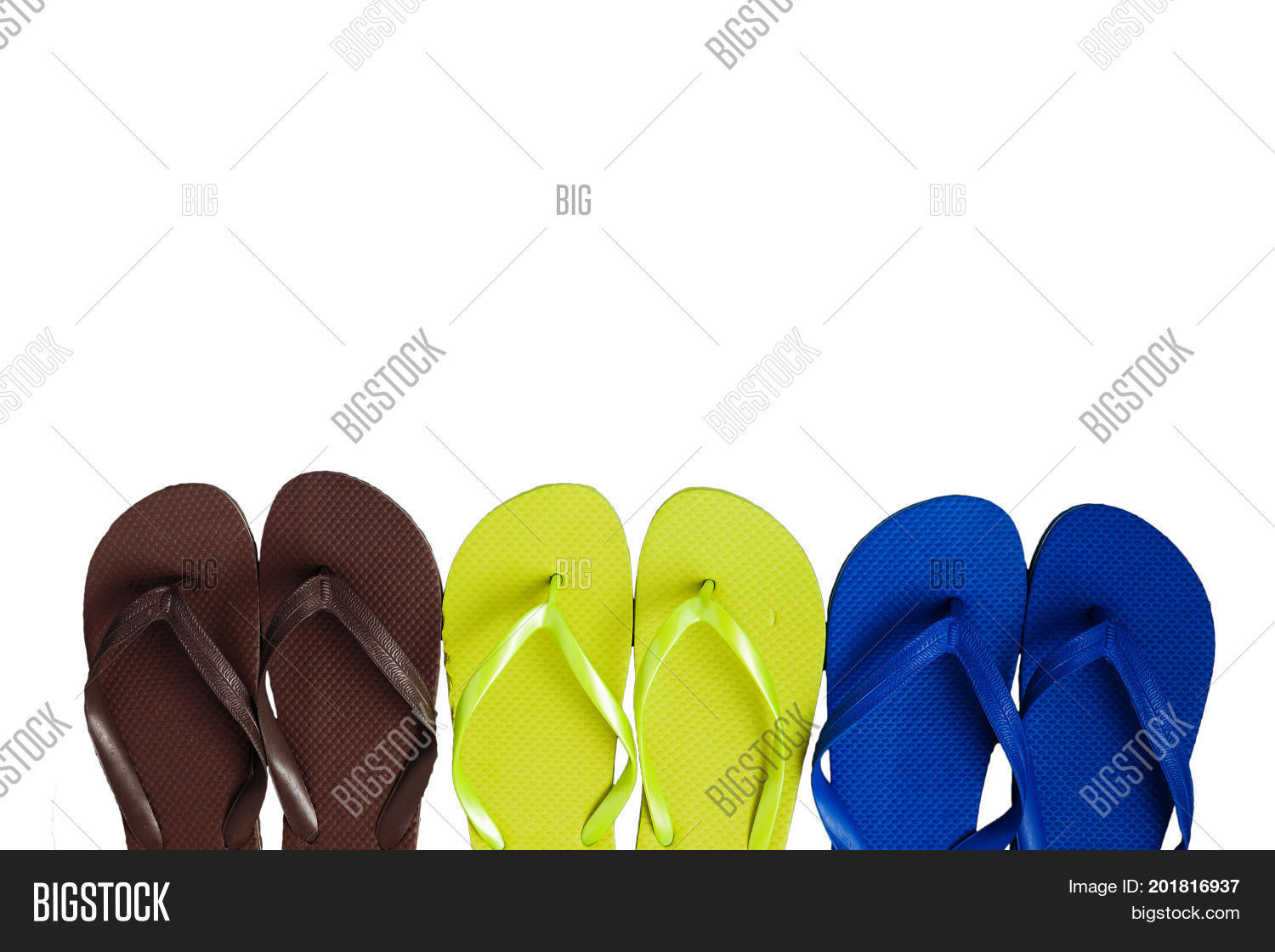 e49d21f57280 Several pairs of multi-colored rubber flip-flops exhibited in a row isolated .