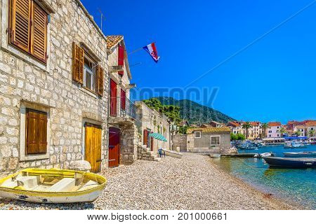 Scenic mediterranean view at Komiza on Island Vis, popular summer destination in Croatia, Europe.