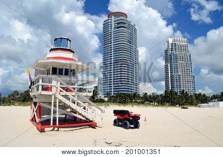 Lifeguard stand and luxury condominium towers overlooking the beach at Soouthpointe Park,Miami Beach,Florida