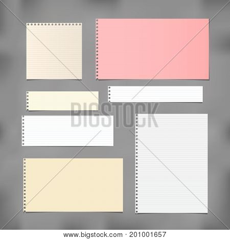 White ruled, striped and colorful note, copybook, notebook paper stuck on grey background