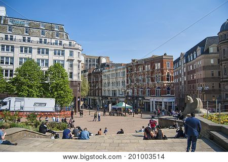 Birmingham, United Kingdom - May 12, 2016: A view to City Council House from Victoria Square in Birmingham, United Kingdom. Locals and tourists. Popular place where locals hang out and chill.