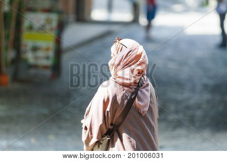 Woman In Traditional Muslim Clothing Goes Street